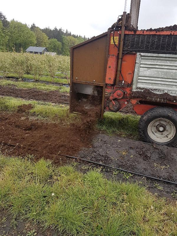 Compost strooi zijkant